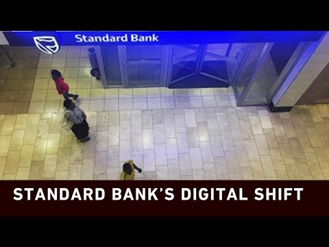 Standard Bank closes branches and cuts jobs.