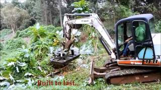 Video still for Brush Wolf Mini Excavator clearing brush in Maui