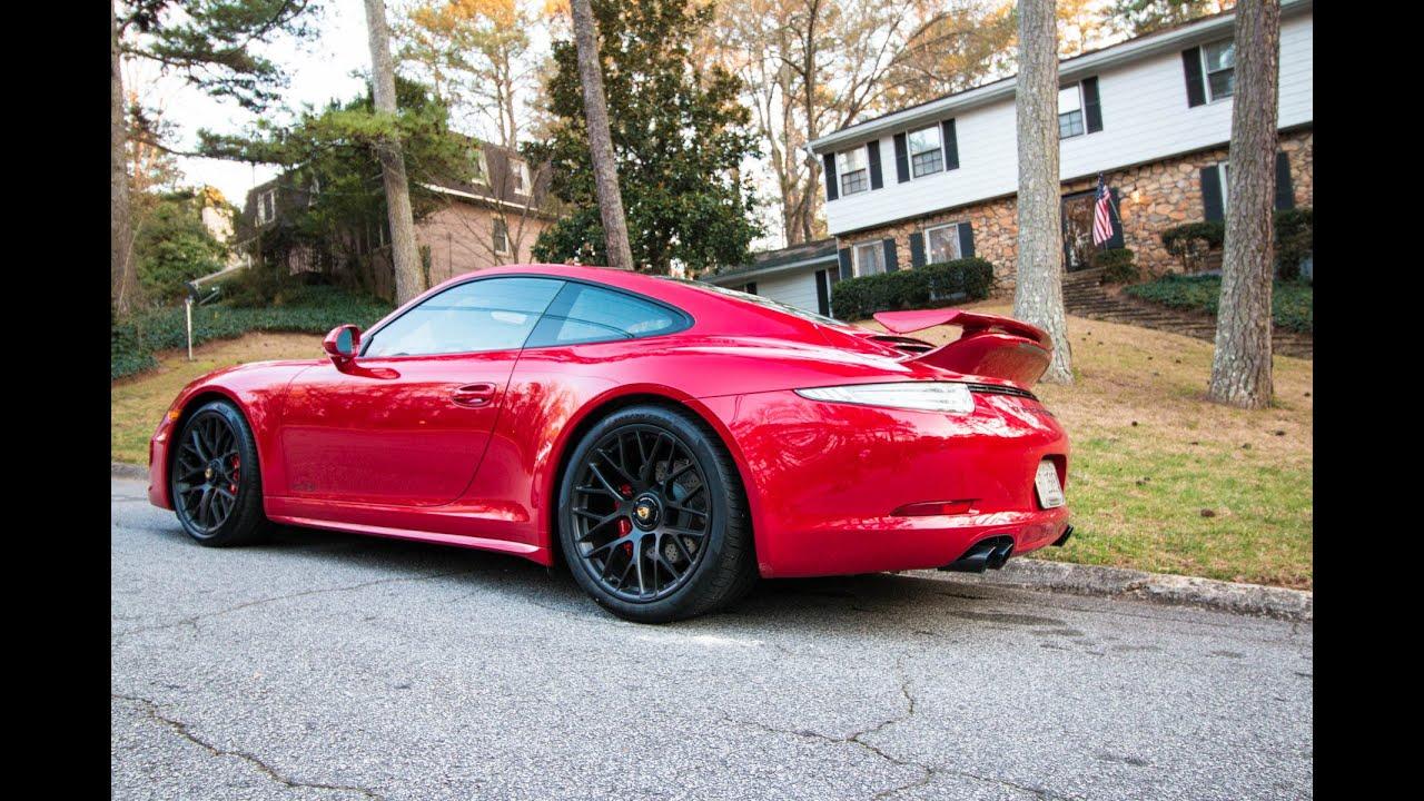 My neighbor brings home his Porsche Carrera GTS