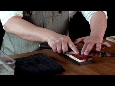 Sharpening a Shun knife on a whetstone