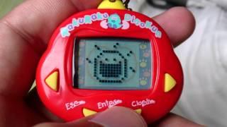 Bichinho Virtual Tamagotchi Rakuraku Dinokun