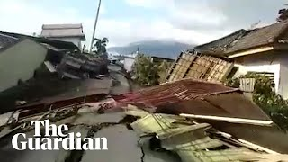 'The car is on top of the house' footage emerges from quake-ravaged Donggala