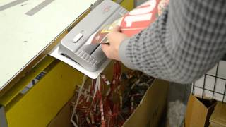 Shredding paper for use as packing material