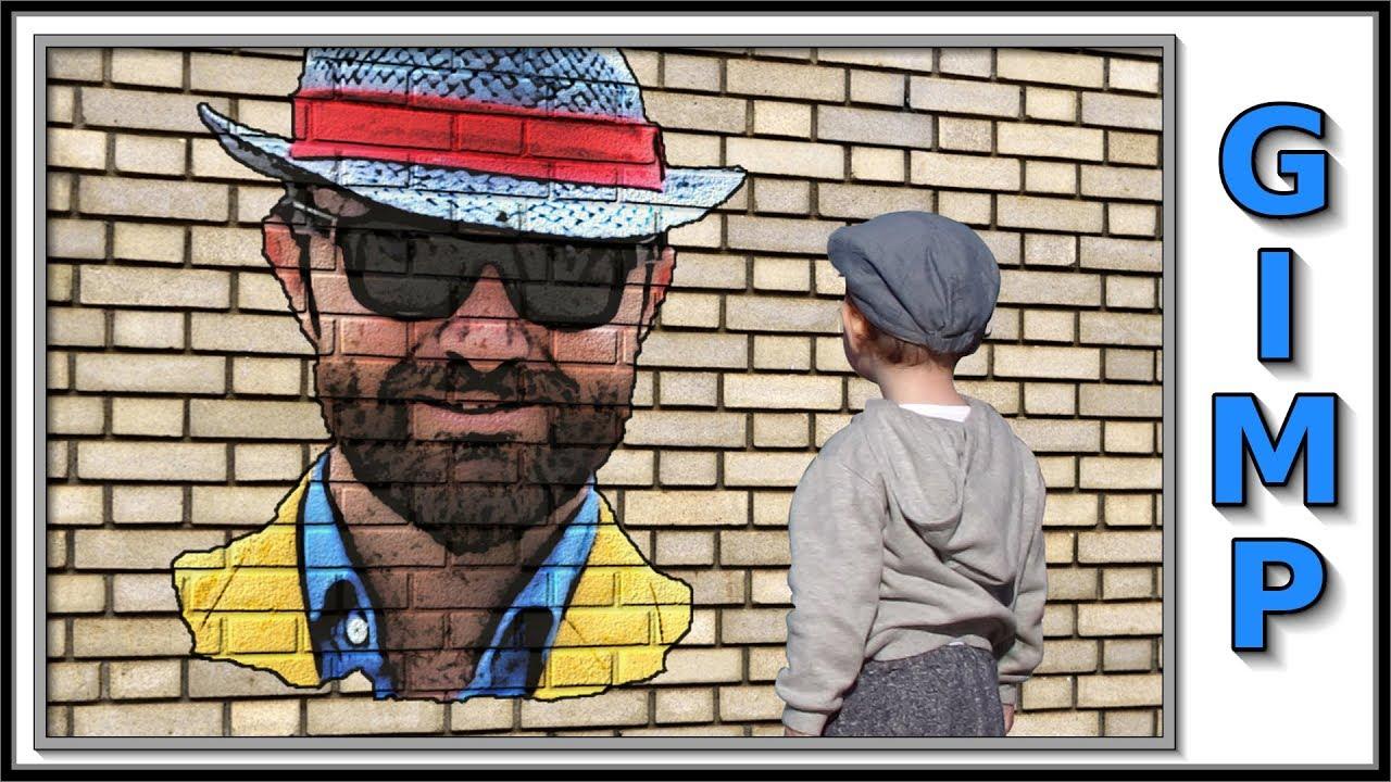 Gimp graffiti portrait on a brick wall