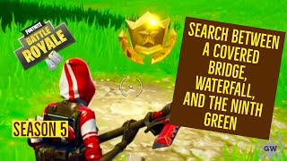 Search Between A Covered Bridge, Waterfall, And The 9th Green FORTNITE MAP LOCATION