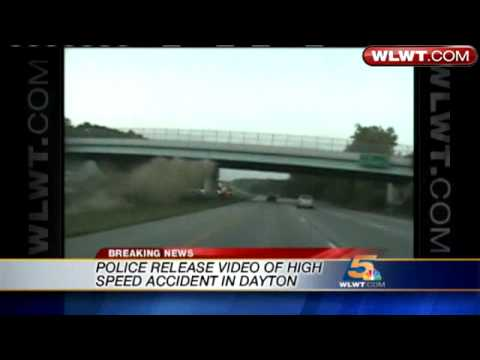 Car Flies Through Air, Crashes Into Pillar
