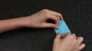 Оригами Цветок ириса(Видеоролик о складывании фигурки оригами свеча. С сайта http://all-origami.ru., 2009-08-25T11:51:23.000Z)