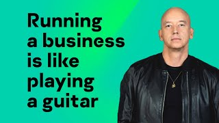 Running a business is like playing a guitar