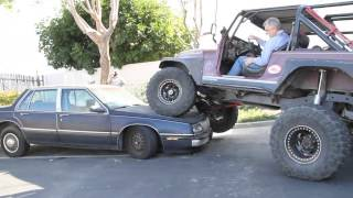 Jeep Scrambler parking on top of another car