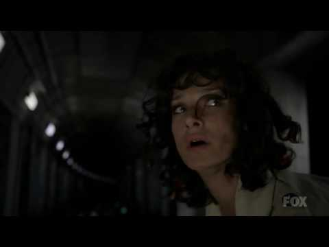 Indira Varma, footboot gets trapped in train track.