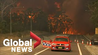 Raging Australian wildfires force residents to water's edge