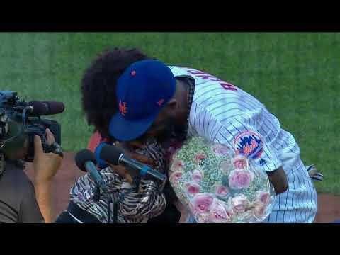 New York Mets' Jose Reyes watches daughter sing National Anthem prior to game vs. Atlanta Braves