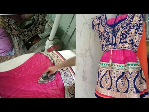 how do dry cleaners dry clean designer lehenga suite  & steam ironing..