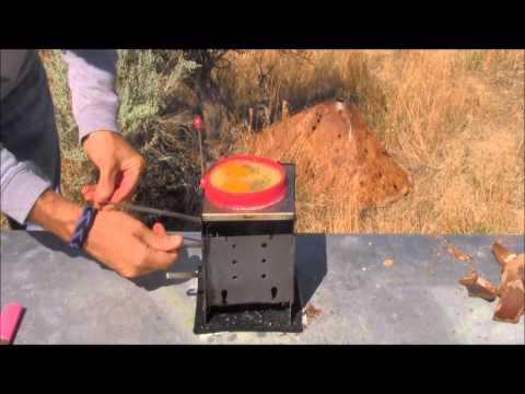 Folding Firebox Stove cooking eggs without a pan using coconut shells as fuel / Carbon Felt test