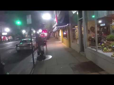 Walking at night in Bowling Green, Ohio down Wooster Street from Downtown