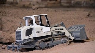 Liebherr 634 track loader working at the road construction site