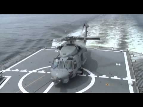 Royal Australian Navy MH-60R 'Romeo' helicopter fires AGM-114 Hellfire missile for the 1st time