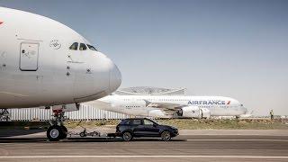 Porsche cayenne towed A380 set a new Guinness World Records