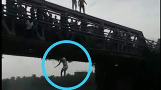 Youths were seen Dangerous jumping in to the River in Pane Mangalore Bridge