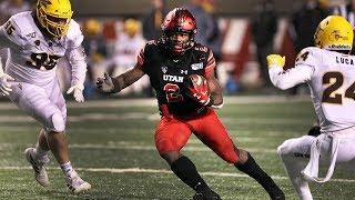 Eddie Johnson congratulates Zack Moss on becoming Utah's career rushing leader