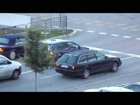 Stupid BMW driver tries drifting on a public road and fails horribly