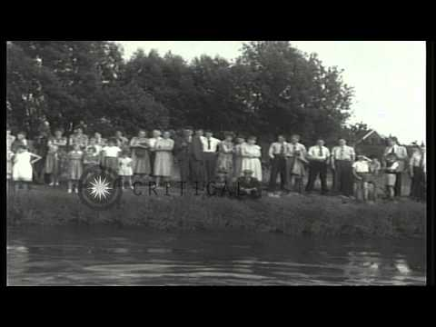 People gather at the bank of Ijssel river to watch the Junior swimming championsh...HD Stock Footage