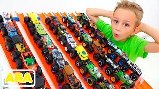 فلاد ونيكيتا يلعبان بشاحنات لعبة الوحش  سيارات هوت ويلز للأطفال