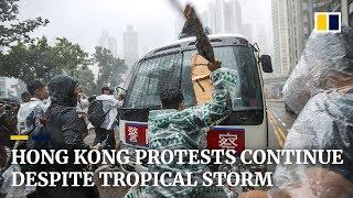 Hong Kong protests continue despite tropical storm