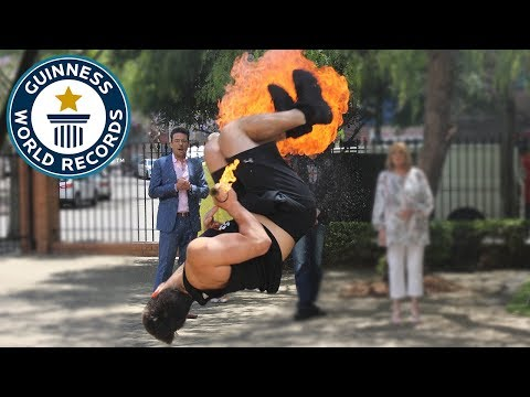Fire breathing full twist backflips in one minute – Guinness World Records Day