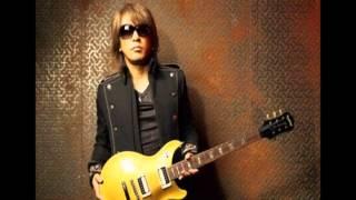 B'z 松本孝弘、ギターの速弾き、ピッキングハーモニクス奏法の練習法を語る。