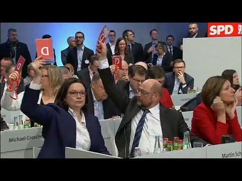 Germany's SPD back coalition talks in narrow vote