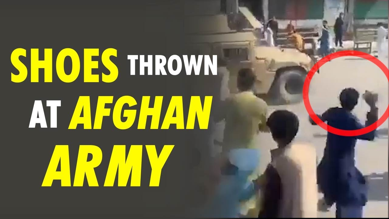 Download Viral Video: Afghan citizens express displeasure with Afghanistan Army by throwing stones and shoes