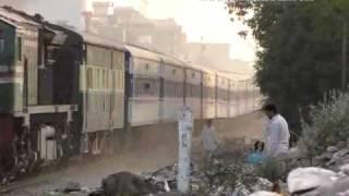 Pakistan Railways trains passing through Chanesar Halt Railway Crossing in Karachi, Pakistan.