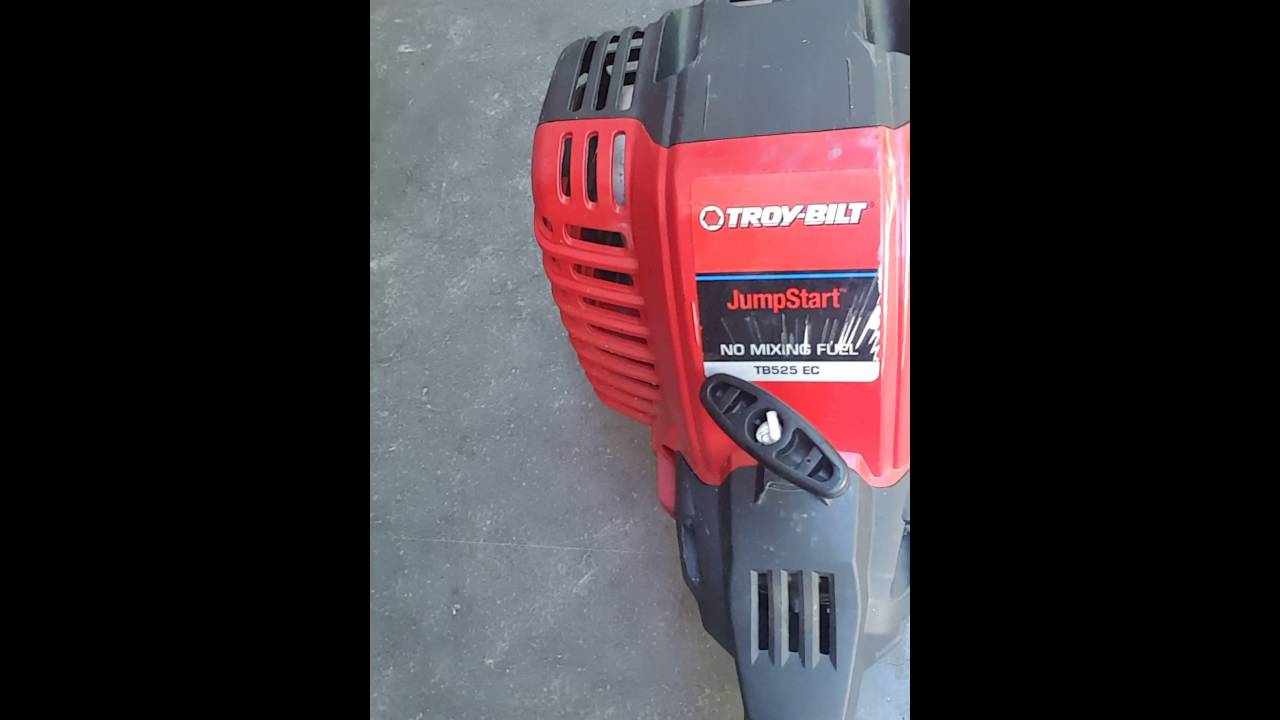 Troy Built TB525 EC weed eater head removal  YouTube