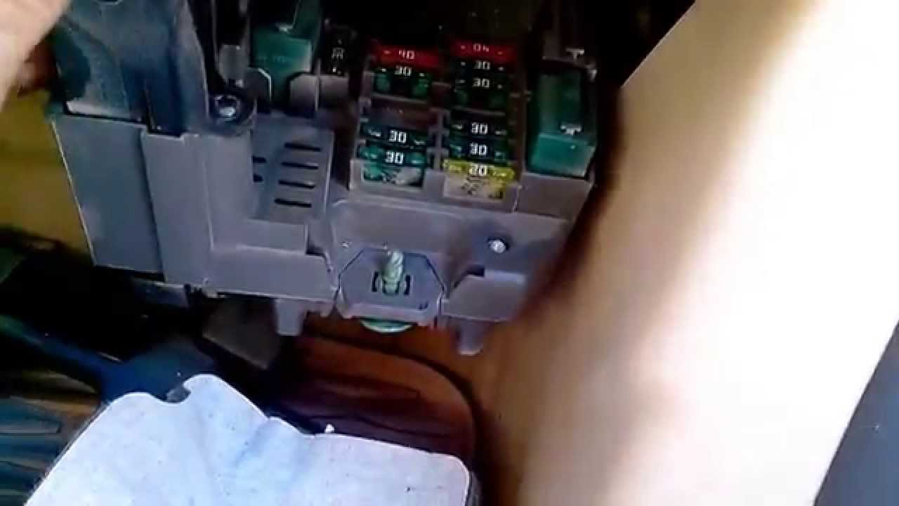 location of front fuse box in bmw x