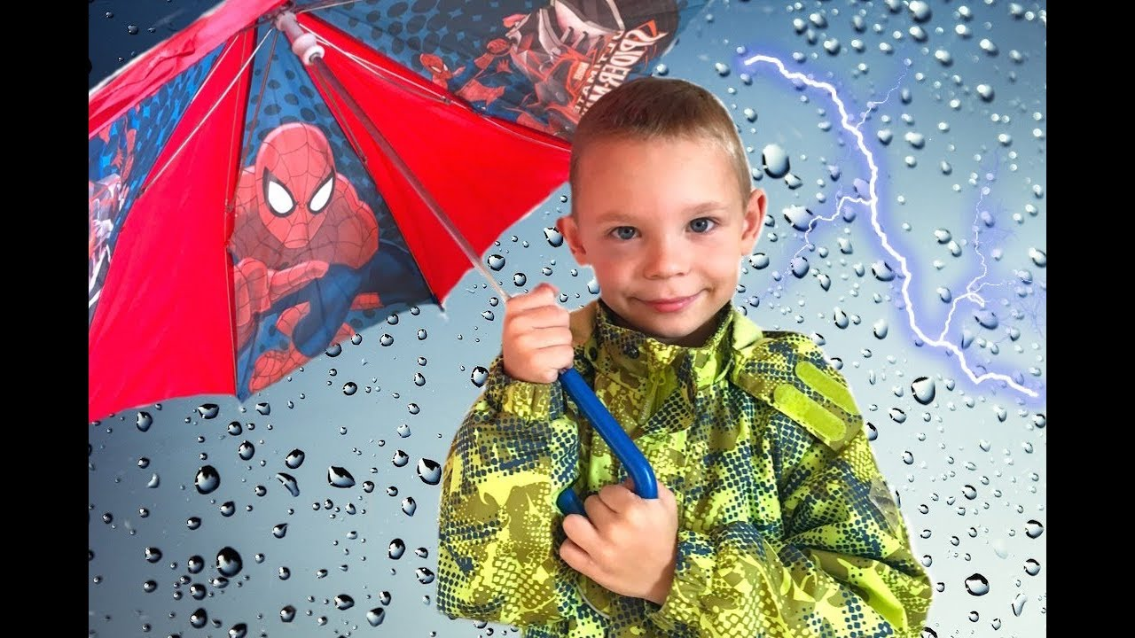 funny kids play with umbrellas for babies after rain colored rain