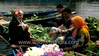 Beautiful Kashmiri girls sell fresh flowers and vegetables on boats in Srinagar, India