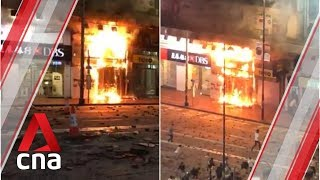 Shop unit beside DBS branch in Hong Kong engulfed in flames