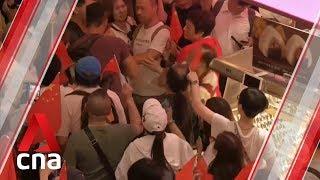 Scuffles between rival protesters at Hong Kong shopping mall