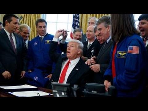 Trump signs NASA bill, pushes Mars missions