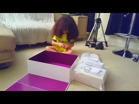 Faroukjames happily opens a package of luxury brands from childrens