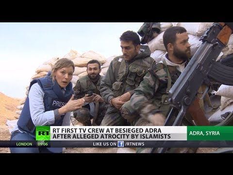 RT first TV crew at besieged Syria town after alleged atrocity by Islamists