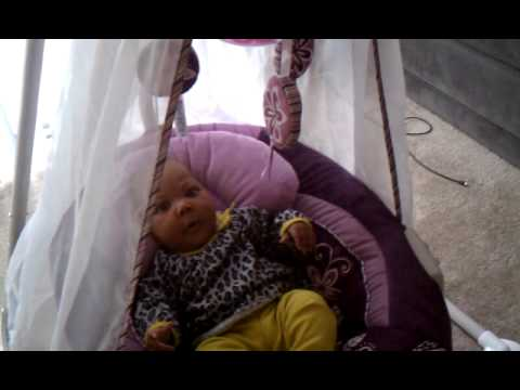 Sarah in Her Swing At Two Months Old