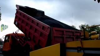 Mitsubishi Colt Dump Truck Loading Asphalt Gravel to Asphalt Paver Finisher