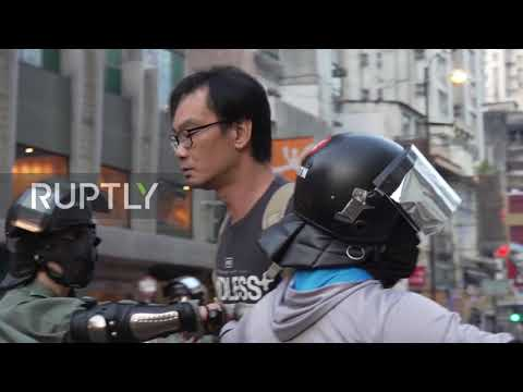 Hong Kong: Angry Commuters Take On Protesters