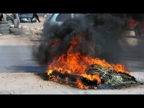Libya: fatal Benghazi clashes between protesters and militia