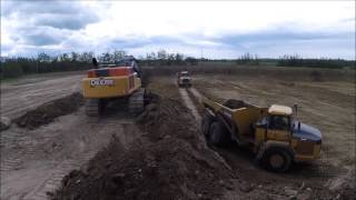 Deere 470G Loading Trucks