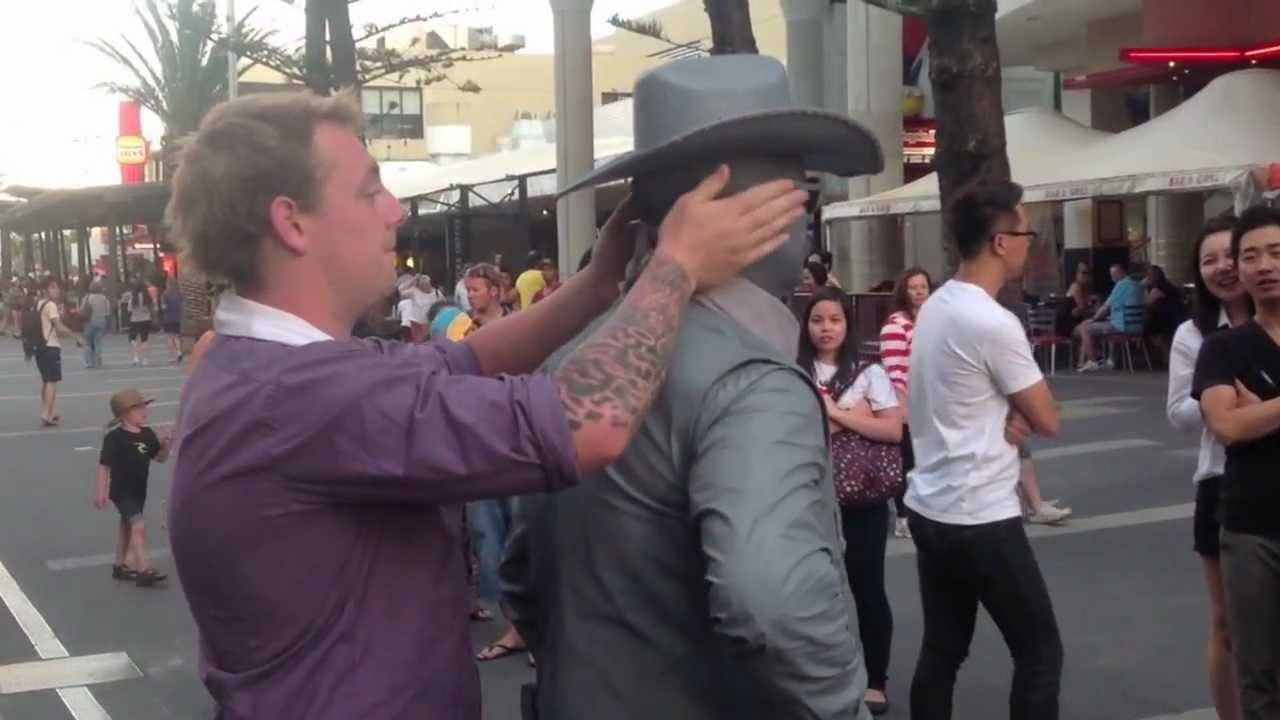 Guy gets punched by street performer! (Original)