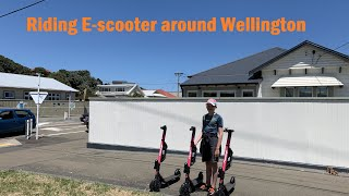 Riding E-scooter.