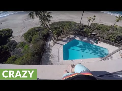 Crazy kid jumps off 6 story balcony into pool